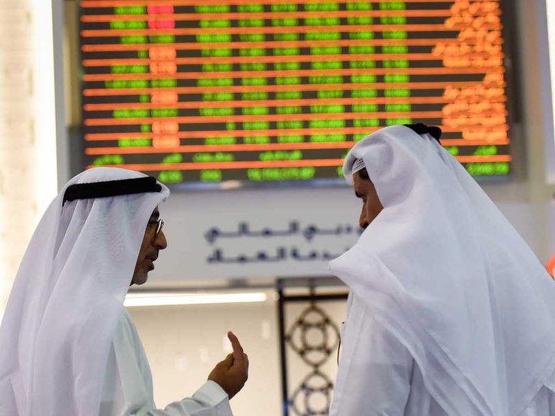 Traders at the Dubai Financial Market (DFM)